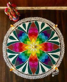 Rangoli designs 2020 for Gudi Padwa are about incorporating flowers in them. Flower wedding rangolis have gained much popularity this wedding season. Indian Rangoli Designs, Rangoli Designs Latest, Simple Rangoli Designs Images, Rangoli Designs Flower, Colorful Rangoli Designs, Flower Rangoli, Beautiful Rangoli Designs, Kolam Designs, Mehndi Designs