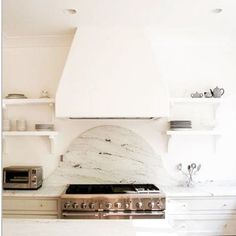 I'm now obsessed with plaster covered range hoods like this one I found from Scout for the Home. The clean airy look is perfect to come home too. Can't wait to get some of my upper cabinets off the wall and put up shelves!