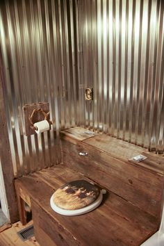 Outhouse inspired toilet cover. Rustic look in potty room