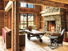 Miller-Roodell Architects was responsible for transforming a reclaimed post and beam barn into a rustic family lodge in Sun Valley, Idaho. Modern Mountain Home, Mountain Living, Mountain Cottage, Idaho, Coffee Table With Wheels, Home Fireplace, Fireplaces, Farmhouse Fireplace, Post And Beam