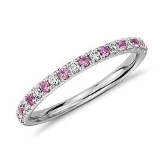 This fun, flirty ring is crafted in a petite design of 14k white gold featuring pavé-set diamonds and pink sapphires.