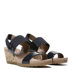The compliments will roll in every time you wear this chic cork-wrapped wedge sandal. Faux leather upper with open toe, elastic heel sling strap and instep strap, metallic stud detail, and cork-wrapped wedge accent.Soft System® comfort package provides all-day support, flex, and cushioningTraction sole provides you with extra stabilityJust Right Height 2 inch wedge heel