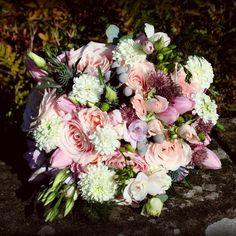 Pink and cream brides bouquet for a November wedding at Clearwell Castle.