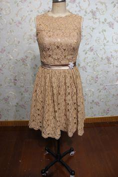 short scoop sleeveless lace bridesmaid dress knee length. $182.00, via Etsy.