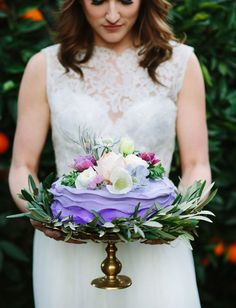 Wedding Cakes Pretty Pastel Wedding Cakes for Your Spring Wedding | The spring garden charm and rustic tones of this lavender frosted cake have us weak in the knees. Pastels and florals are always a winning combination for wedding desserts