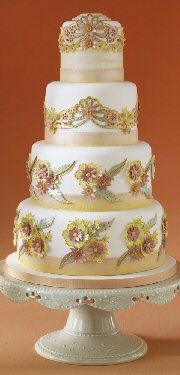 Love this stunning wedding cake.  Soft, elegant and the emblishments make the cake.