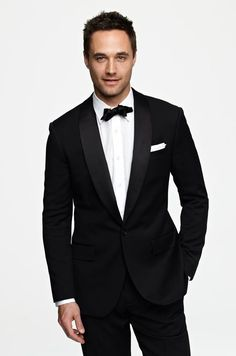 If your bride has chosen a fancier gown for your informal evening winter wedding, don a tuxedo (we love the Ludlow from J.Crew) to match her formality.