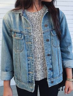 sweater, denim jacket, & black fitted denim jeans