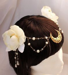 Inspired by the art of Mucha and Sailor Moon this headdress has a irresistible elegant look. Made of faux roses featuring a large filigree golden