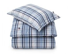 The homespun feel of our quality poplin duvet cover features a timeless Lexington look in a check design of 100% poplin cotton. Along with Lexington rubber button closures on the duvet cover, our Madrass check in multi colors brings a cozy and inviting touch to your bedroom. Duvet and pillowcase sold separately.