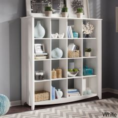 Save space and show off your books and collectibles in style with this modern cube bookcase.