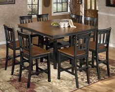 Owingsville 9-Piece Square Counter Extension Table Set by Signature Design by Ashley   Part of the Owingsville Collection Sku: D580-32+8x224 Store Availability: In Stock and On Display Compare At Price: $2,679.91 Sale Price: $1,489.91