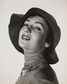 'Woman in hat with necklace', c 1960.