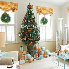 Turquoise-and-Orange Color Scheme | Orange ribbon wraps large boxes covered in patterned turquoise paper and an urn with oranges dresses up the bottom of the Christmas tree. For a business. in a Pot!