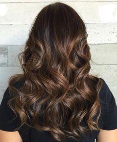 Dark brunette with bayalage low lights.