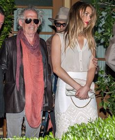 Keith Richards, Amber Heard, and Johnny.