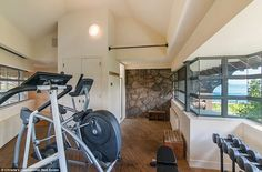 Sweat with a view: The home's second floor features a gym with exercise machines, weights ...