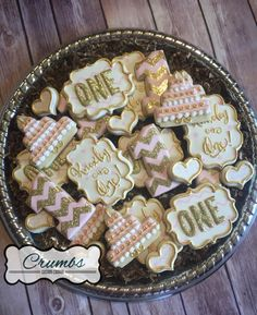 Pink and gold first birthday sugar cookies by @CrumbsCustomCookies on Instagram