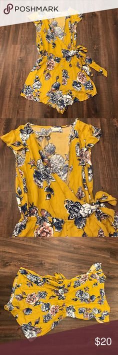Adorable yellow floral romper. Never worn! Adorable yellow floral romper. Never worn! Dresses