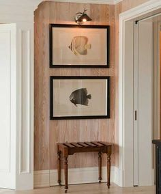 This small space feels finished with the wall treatment, art, and light.