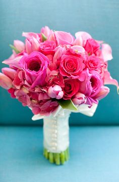 Beautiful bouquet with roses and callalilies.  Love the texture and the different, bright, colors.