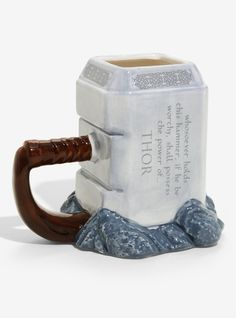 Marvel Thor Mjolnir Mug Whosoever holds this hammer if he be worthy shall possess the power of Thor. Whosoever holds this mug if they be worthy shall possess the power of caffeine! This ceramic sculpted mug features a Mjolnir inspired design. Cute Coffee Mugs, Cool Mugs, Coffee Cups, Thor, Deco Disney, To Go Becher, Disney Mugs, Cute Cups, Yanko Design