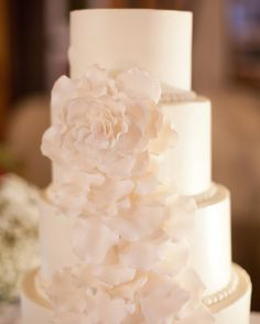 The almond-and-buttercream cake baked by FlourGirl Patissier boasted delicate sugar flowers made by Sugar Flower Cake Shop.