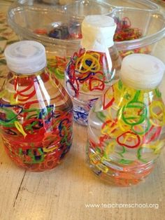 Rubber loom bands in a discovery bottle Loom Band Discovery Bottles by Teach Preschool Sensory Bottles For Toddlers, Sensory Bags, Sensory Activities, Infant Activities, Activities For Kids, Sensory Bottles Preschool, Sensory Table, Sensory Play, Learning Activities