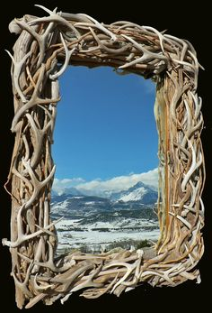 Antler and wood trimmed mirror. Etsy store: lightshipsart