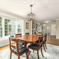 Bright and open dining room with hardwood flooring, modern light fixture and signs lines to the family room and kitchen. Listed for $1,150,000 in Vienna, VA by The Casey Samson Team is a Wall Street Journal Top Team in Northern Virginia.