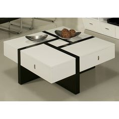 @Overstock - Jumeirah Coffee Table - Add a stylish touch to your decor with this wooden coffee table. A white wood with a glossy black design highlights this durable table.      http://www.overstock.com/Home-Garden/Jumeirah-Coffee-Table/7292233/product.html?CID=214117  $869.99