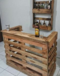 The pallet ought to be in a position to support the weight of your bike and ought to have slits on each side so that it can be lifted by means of a fo. diy bar Wonderful Pallet Furniture Ideas and Tips to Make Your Happy Wood Pallet Bar, Wooden Pallet Projects, Wooden Pallet Furniture, Bar Furniture, Wooden Pallets, Wooden Diy, Furniture Stores, Pallet Patio, Pallet Chair