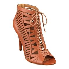 As seen in the March issues of Glamour, InStyle and People Style Watch magazines, our Angelica lace-up high heel pumps take chic to a whole new level! Cut-out detailing. Back zip for easy on/off. Padded footbed for all-day comfort. Leather upper. Man-made lining and sole. Imported. 4 inch heels. Women's shoes. Lace-up, peep-toe high heels.