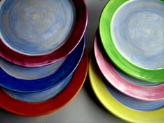 These beautiful colorful salad or side plates will brighten up your everyday.   Wheel thrown they are made of stoneware. Surprisingly light