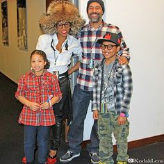 June Ambrose lets her hat go wild while taking a family portrait alongside her husband and children backstage at the Barclay's Center in New York City.