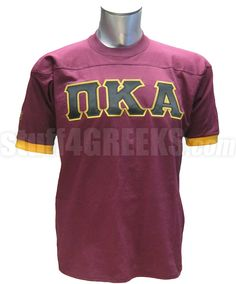 Maroon Pi Kappa Alpha crossing jersey with gold cuffs and the Greek letters across the chest.