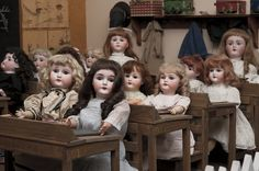 A school room full of antique German bisque dolls at the Arizona Doll and Toy Museum. Photo by Daniel Friedman.