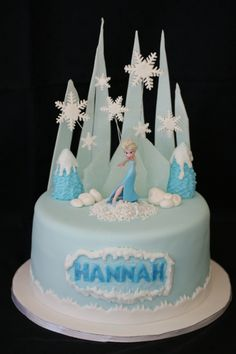 "Frozen ""Elsa"" Cake- Jayda on front, white chocolate food dyed light blue, jagged pieces ontop of cake.  Royal icing base & snowflakes."