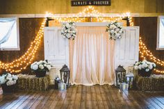 Creative Events   Rustic Doors used as a back drop for ceremony and reception.   Venue: Coulee Creek Farms