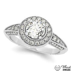 Round Halo Engagement Ring with Milgrain Edges and Diamond Encrusted Band available at Wheat Jewelers