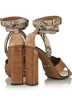 Wooden block heel measures approximately 110mm/ 4.5 inches with a 10mm/ 0.5 inches platform Python, tan leather Buckle-fastening ankle strap Python: Vietnam