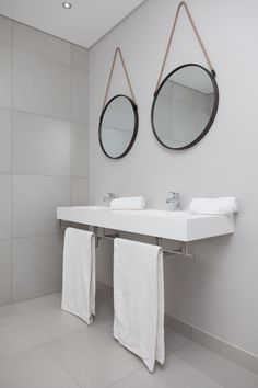 Situated on the Gary Player designed Golf Course of Langebaan Country Estate, this home is the perfect balance of stylish up-market design. Light Grey Bathrooms, Modern Bathroom, Stainless Steel Towel Rail, Shower Alcove, New House Construction, Open Showers, Rustic Mirrors, Metal Mirror, Floating Wall