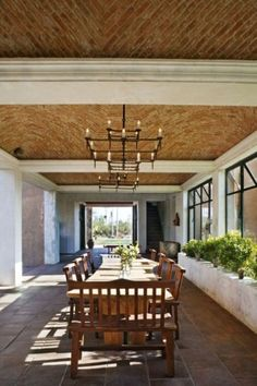 Hacienda style in Mexico /    The light fixtures were custom designed by Howell's wife, Steffani Aarons; their form and materials create a beautiful transition in the space between the boveda ceilings and the metal window casements.