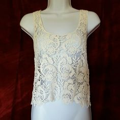 """Battenburg Lace Crop Tank Beautiful cropped tank top in ivory lace.  NEVER WORN! It says """"One Size"""" but I would say Small to Medium. Issue Tops Tank Tops"""