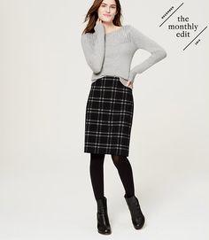 light grey sweater w/ dark plaid wool skirt