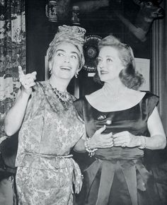 Film stars Joan Crawford and Bette Davis are shown united at party in their honor to celebrate Premier of their new film What Ever Happened To Baby Jane, which had opened