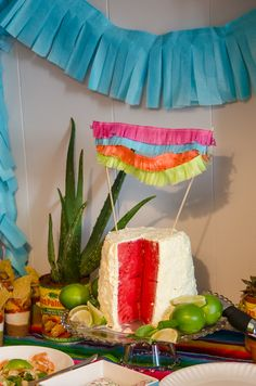 Cake bunting and succulent decorations. A Fiesta Baby Shower! - lemonthistle.com