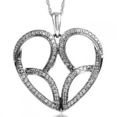 """10K White Gold 1/2 CTW Diamond Heart Pendant. Part of the Jessica Simpson, """"I Am Irresistible"""" Collection. Each piece is set with round brilliant cut diamonds. Chain included."""