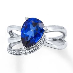 Makes me think of a baby in their mond arns! Love this!! Vibrant color from a pear-shaped lab-created blue sapphire captures attention in this contemporary sterling silver ring for her. A swirl lined with lab-created white sapphire accents provides sparkling contrast to complete the look.