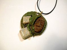 It's Tiki Time! brown & green polymer clay and resin jewelry pendant necklace handmade One of a Kind by LynzCraftz on Etsy